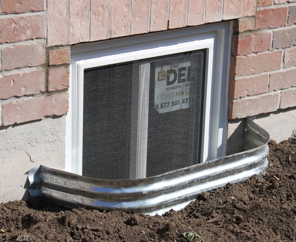 Egress Window Installation in Oakville Ontario, Cutout in cement